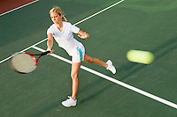 Tennis Player hitting tennis ball with forehand