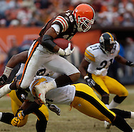 MORNING JOURNAL/DAVID RICHARD.Browns' kickoff returner Joshua Cribbs is tripped up a return yesterday.