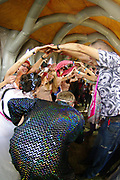 A crowd form a human archway for married couple inside an inflatable church, Boomtown, Matterley Estate, Alresford Road, Winchester, Hampshire, UK, August, 2010