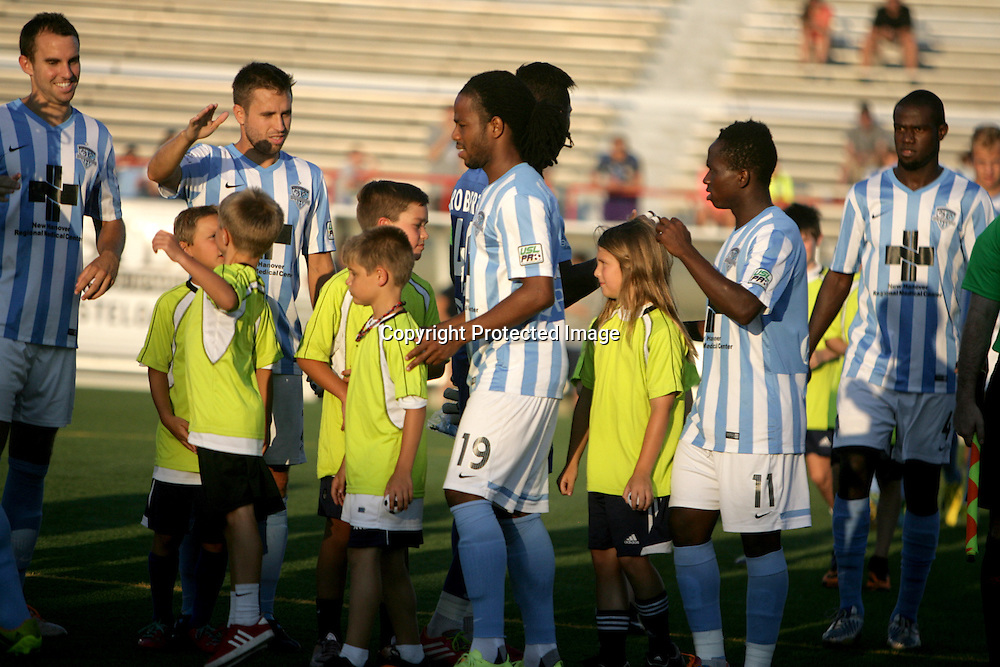 Members of Wilmington Hammerheads FC take the field before their friendly match against Toronto FC Wednesday June 18, 2014 at Legion Stadium in Wilmington, N.C. (Jason A. Frizzelle)