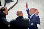 A floor trader gestures while talking to two other men outside the NYSE Euronext Stock Exchange on Wall Street.