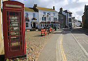 Traditional red telephone kiosk box in village square ,Marazion Cornwall, England, UK