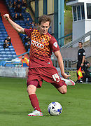 Josh Morris unleashes a  cross into the area during the Sky Bet League 1 match between Oldham Athletic and Bradford City at Boundary Park, Oldham, England on 5 September 2015. Photo by Mark Pollitt.
