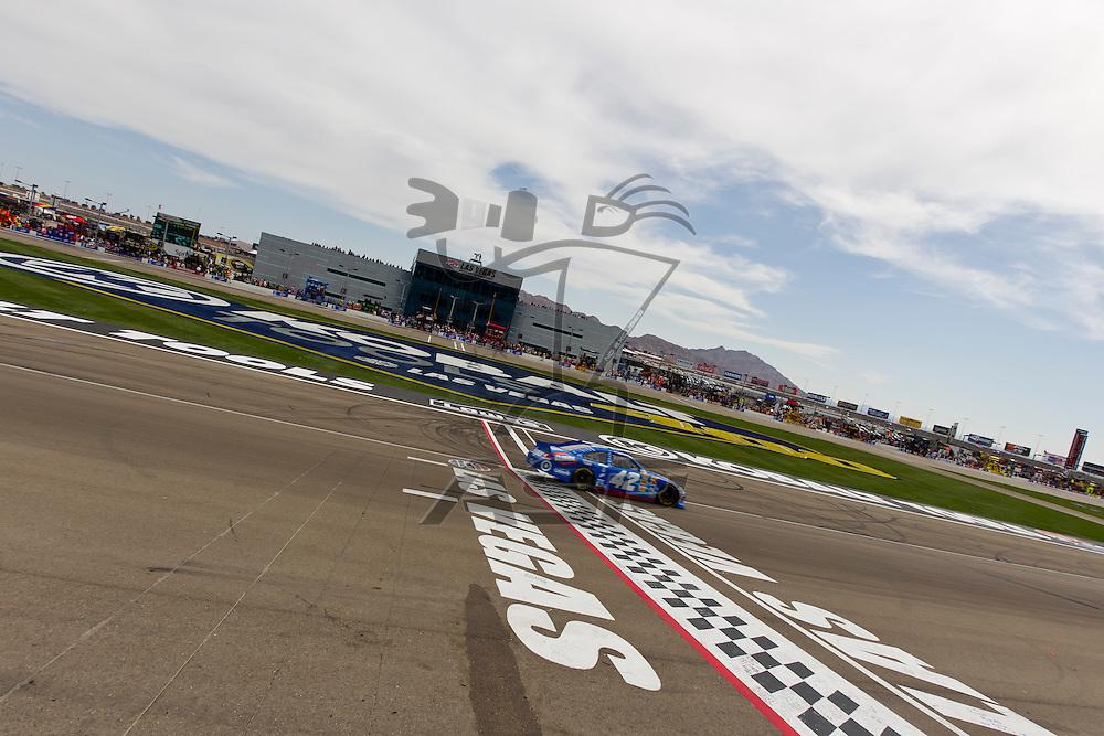 LAS VEGAS, NV - MAR 11, 2012:  Juan Pablo Montoya (42)  crosses the finish line at the Kobalt Tools 400 NASCAR race in Las Vegas, NV.