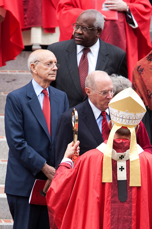Cardinal Donald Wuerl, Archbishop of Washington, speaks with Supreme Court Justices Anthony Kennedy, (C), and his wife Mary Davis, Stephen Bryer (L) and his wife Joanna Freda Hare, and Clarence Thomas (Top C) as they leave St. Matthew's Cathedral after attending the Red Mass in Washington on October 2, 2011. The Red Mass is held annually in Washington, a day before the Supreme Court's new term opens.     REUTERS/Joshua Roberts    (UNITED STATES)