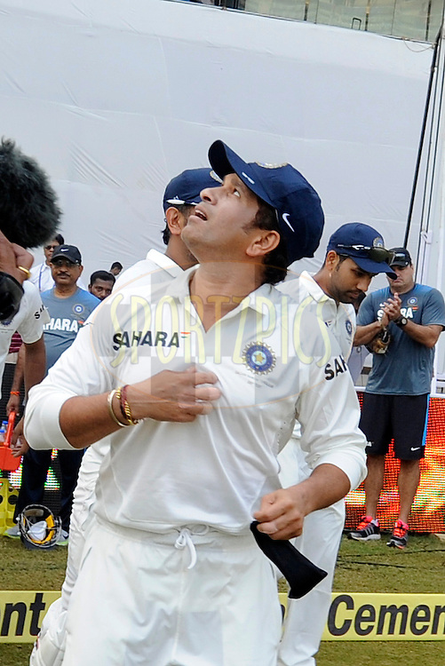 Sachin Tendulkar of India walks to the middle as Team India gets ready to field during day one of the second Star Sports test match between India and The West Indies held at The Wankhede Stadium in Mumbai, India on the 14th November 2013<br /> <br /> This test match is the 200th test match for Sachin Tendulkar and his last for India.  After a career spanning more than 24yrs Sachin is retiring from cricket and this test match is his last appearance on the field of play.<br /> <br /> Photo by: Pal PIllai - BCCI - SPORTZPICS<br /> <br /> Use of this image is subject to the terms and conditions as outlined by the BCCI. These terms can be found by following this link:<br /> <br /> http://sportzpics.photoshelter.com/gallery/BCCI-Image-Terms/G0000ahUVIIEBQ84/C0000whs75.ajndY