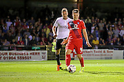 James Berrett during the Capital One Cup match between York City and Bradford City at Bootham Crescent, York, England on 11 August 2015. Photo by Simon Davies.