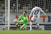 Kieran O'Hara of Burton Albion (1) saves from Nathan Holland of Oxford United (27) during the EFL Sky Bet League 1 match between Burton Albion and Oxford United at the Pirelli Stadium, Burton upon Trent, England on 11 February 2020.