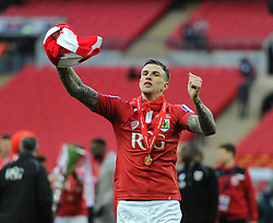 Bristol City's Aden Flint celebrates winning the Johnstone Paint Trophy. - Photo mandatory by-line: Dougie Allward/JMP - Mobile: 07966 386802 - 22/03/2015 - SPORT - Football - London - Wembley Stadium - Bristol City v Walsall - Johnstone Paint Trophy Final