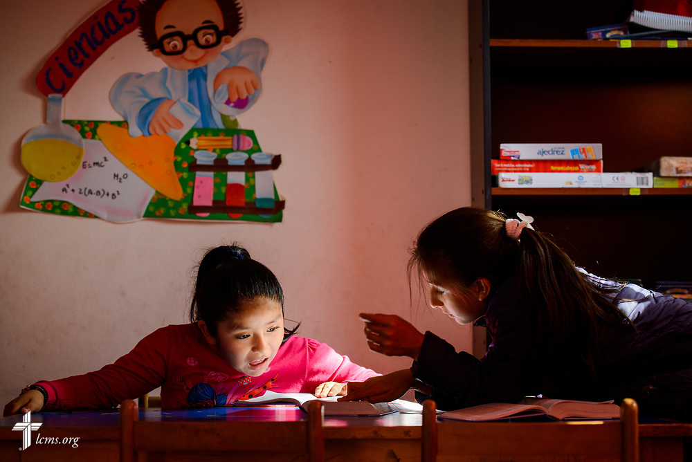 Children read the Bible at Castillo Fuerte in the La Victoria district of Lima, Peru on Monday, Nov. 6, 2017.  LCMS Communications/Erik M. Lunsford