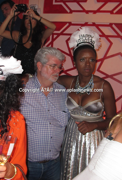 EXCLUSIVE: Roman Abramovich's NYE party in St. Barth, Caribbean.<br /><br />Pictured: George Lucas and Mellody Hobson<br />Ref: SPL346842  311211   EXCLUSIVE<br />Picture by: CelebrityVibe / Splash News<br /><br />Splash News and Pictures<br />Los Angeles:310-821-2666<br />New York:212-619-2666<br />London:870-934-2666<br />photodesk@splashnews.com
