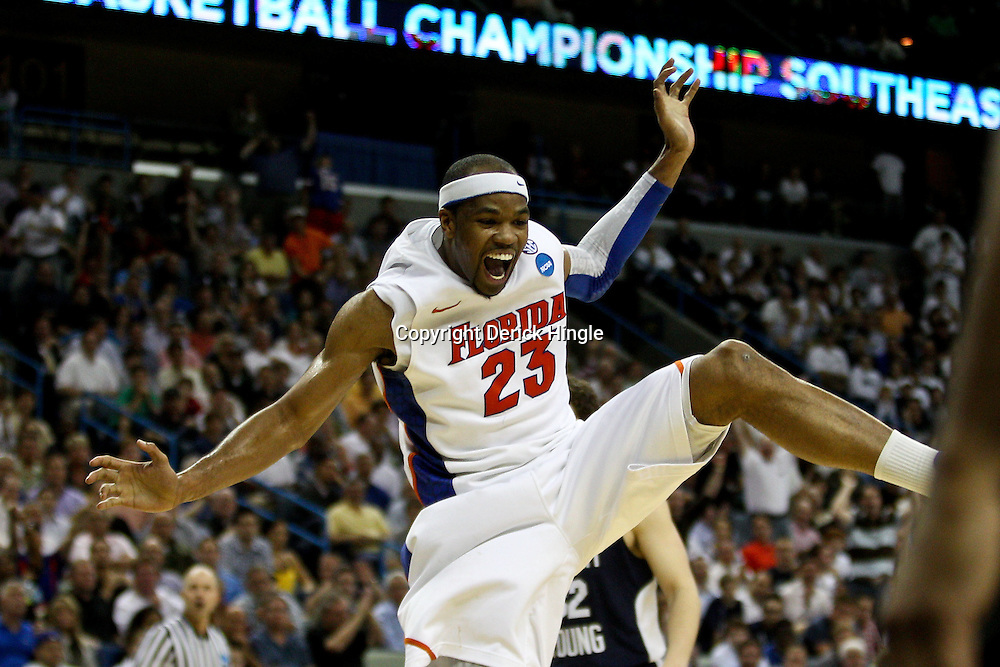Mar 24, 2011; New Orleans, LA; Florida Gators forward Alex Tyus (23) celebrates after dunking during overtime of the semifinals of the southeast regional of the 2011 NCAA men's basketball tournament against the Brigham Young Cougars at New Orleans Arena. Florida defeated BYU 83-74.   Mandatory Credit: Derick E. Hingle