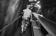 MINER CHECKING THE CONVEYOR BELT WHICH BRINGS THE COAL UP FROM UNDERGROUND DURING HIS TEN HOURS SHIFT AT LONGANNET COLLIERY, CULROSS. SCOTLAND, APRIL, 2001.