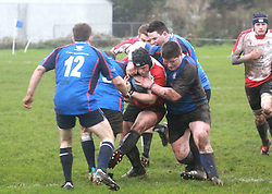 Matthew and Jp Walsh put the squeeze on Cooke's loose forwards...Pic Conor McKeown