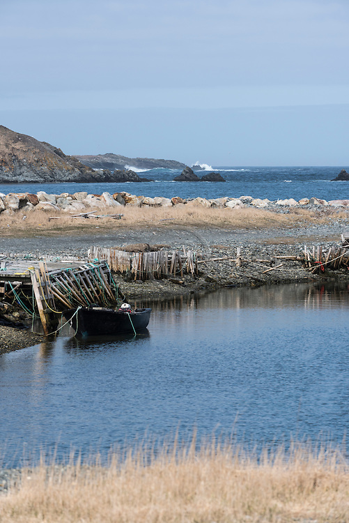 Lone boat sheltered from the Atlantic sea in Ferryland, NL Canada