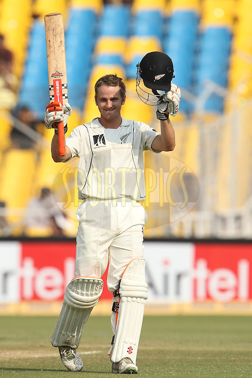 Kane Williamson of New Zealand celebrates his century (100, ton) on his debut during day 4 of the first test match between India and New Zealand  held at the Sardar Patel Gujarat Stadium in Ahmedabad on the 7th November 2010..Photo by Ron Gaunt/BCCI/SPORTZPICS