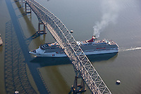 Aerial of Key Bridge with Carnival Cruise ship sailing under