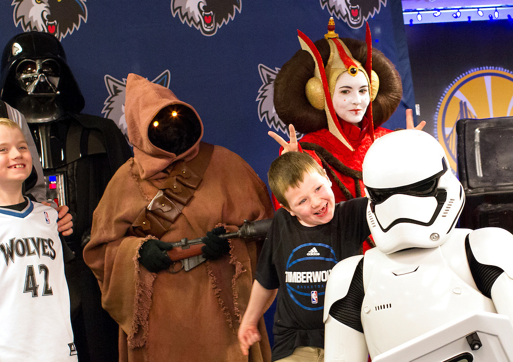 Patrick Mullins, 7, right, of Plymouth goofs around with a Storm Trooper as he and his brother Patrick, 7, take a photo with members of the 501st Legion Central Garrison at Star Wars night at the Timberwolves game at Target Center in Minneapolis December 15, 2015.
