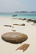 Stones and boat in the beach at   Chapera Island. Las Perlas archipelago, Panama province, Panama, Central America.