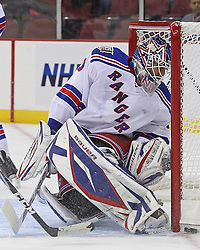 Nov 5, 2010; Newark, NJ, USA;  New York Rangers goalie Henrik Lundqvist (30) watches the puck slide just wide during the first period of their game against the New Jersey Devils at the Prudential Center.