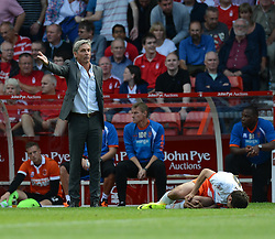BlackPool's Manger Jose Riga give his players while BlackPool's Donervon Daniels is on the floor in front of him after getting fouled. - Photo mandatory by-line: Alex James/JMP - Mobile: 07966 386802 09/08/2014 - SPORT - FOOTBALL - Nottingham - City Ground - Nottingham Forest v Blackpool - Sky Bet Championship - First game of the season
