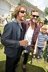 Left to right, JAY KAY and WILL YOUNG at a luncheon hosted by Cartier for their sponsorship of the Style et Luxe part of the Goodwood Festival of Speed at Goodwood House, West Sussex on 5th July 2009.