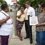 09/10/2013  MATTAPAN, MA   Homicide victim family member Mary Franklin (cq) (left) spoke with mayoral candidate John Connolly (cq) on Woodrow Avenue (cq) in Mattapan at the location her husband Melvin Franklin (cq) was killed in 1996. Fellow homicide victim family members Natalie Logan (cq) (left) and Carrie Fletcher (cq) (right) joined them.  (Aram Boghosian for The Boston Globe)