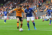 Hull City player George Honeyman (18) and Cardiff City player Nathaniel Mendez-Laing (19)  during the EFL Sky Bet Championship match between Hull City and Cardiff City at the KCOM Stadium, Kingston upon Hull, England on 28 September 2019.