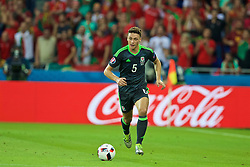 LYON, FRANCE - Wednesday, July 6, 2016: Wales' James Chester in action against Portugal during the UEFA Euro 2016 Championship Semi-Final match at the Stade de Lyon. (Pic by David Rawcliffe/Propaganda)