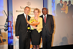 Left to right, GRAHAM BOYES, KATE BLEASDALE and SIR TREVOR MACDONALD at the presentation of the Veuve Clicquot Business Woman Award 2009 hosted by Graham Boyes MD Moet Hennessy UK and presented by Sir Trevor Macdonald at The Saatchi Gallery, Duke of York's Square, Kings Road, London SW1 on 28th April 2009.