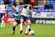 Bolton Wanderers midfielder Jason Lowe in a challenge with the opponent  during the EFL Sky Bet League 1 match between Bolton Wanderers and Wycombe Wanderers at the University of  Bolton Stadium, Bolton, England on 15 February 2020.