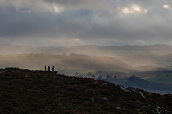 © Licensed to London News Pictures. 02/11/2019. Chesterfield, UK. Three walkers on Curbar Edge, Derbyshire, enjoy a break in the weather after heavy rain and strong winds have hit large areas of the UK this weekend. Photo credit : Tom Nicholson/LNP