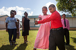 Jireh Mathurin, left, and dance partner Joshua Calcano dance together after their culminating event at the Claude O. Markoe Elementary School Dancing Classrooms VI Culminating Event.  17 December 2015.  Christiansted, St. Croix.   © Aisha-Zakiya Boyd.