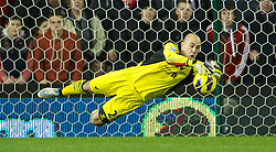 26.12.2012, Britannia Stadion, Stoke on Trent, ENG, Premier League, Stoke City vs FC Liverpool, 19. Runde, im Bild Liverpool's goalkeeper Jose Reina makes a save against Stoke City during the English Premier League 19th round match between Stoke City FC and FC Liverpool at the Britannia Stadium, Stoke on Trent, Great Britain on 2012/12/26. EXPA Pictures © 2012, PhotoCredit: EXPA/ Propagandaphoto/ David Rawcliffe..***** ATTENTION - OUT OF ENG, GBR, UK *****