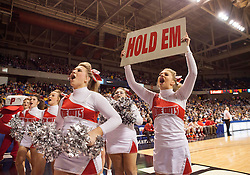 Poca cheerleaders pump up the crowd during a semi-final game at the Charleston Civic Center.