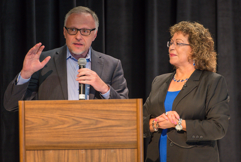 Mark Smith comments with Gloria Salazar during a dedication and ribbon cutting ceremony at Katherine Smith Elementary School, April 27, 2016.