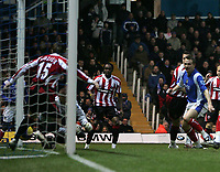 Photo: Lee Earle.<br /> Portsmouth v Sheffield United. The Barclays Premiership. 23/12/2006. United's Robert Kozluk (L) turns the ball into his own net for Pompey's equaliser.