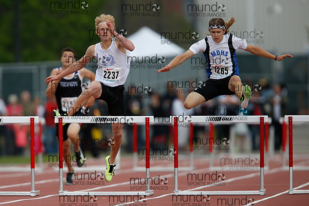 Adrain Camara of Mother Teresa CSS - Scarboro competes in the intermediate hurdle finals at the 2013 OFSAA Track and Field Championship in Oshawa Ontario, Saturday,  June 8, 2013.<br /> Mundo Sport Images/ Geoff Robins