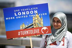 © Licensed to London News Pictures. 03/06/2018. London, UK. Campaigners from Turn To Love gather on London Bridge ahead of a minutes silence for the victims of the 2017 London Bridge Terror attack, held on London Bridge. Eight people were killed and 48 were injured when a van was deliberately driven into pedestrians on London Bridge. Three occupants then ran to the nearby Borough Market area carrying knives and fake explosives. Photo credit: Ben Cawthra/LNP