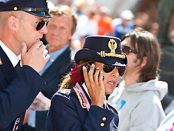 21.05.2011, Hauptplatz Lienz, AUT, Giro d´ Italia 2011, 14. Etappe, Lienz - Monte Zoncolan, im Bild Feature Carabiniere, eine bildhübsche Carabiniere Beamte beim telefonieren, während sich ihr Kollege an das Kinn fasst // during the Giro d´ Italia 2011, Stage 14, Lienz - Monte Zoncolan,Austria, 2011-05-21, EXPA Pictures © 2011, PhotoCredit: EXPA/ J. Feichter