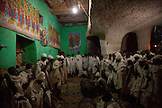 "Priests sing, pray and chant throughout the night during a special ceremony marking the birthday of the Saint of this ancient rock-hewn church. Occupying a high plateau and bordering with Eritrea in the very north of Ethiopia lies the ancient Province of Tigray. It is an area widely considered to be the fulcrum of Ethiopian culture with towns dated to before the birth of Christ. Distinctively different from the rest of Ethiopia, strongly Orthodox Christian and culturally proud, Tigray is a mountainous and rocky region dotted with ancient churches carved in to sandstone cliffs. Filling these churches are old religious manuscripts and Bibles safe-guarded by protective Priests. Its remoteness has protected the culture as well as the religious sanctuaries that have been described as ""the greatest of the historical-cultural heritages of the Ethiopian people"". But now Tigray is at a crossroads. Improved infrastructure has led to an opening up of even the remotest towns and villages. Signs of modernity such as internet cafes and cell phones are increasingly being used by younger Tigraians dressed in jeans and T-shirts. Yet the Church remains an ancient and powerful institution which protects its ancient customs creating scenes that haven't changed since Biblical times.."