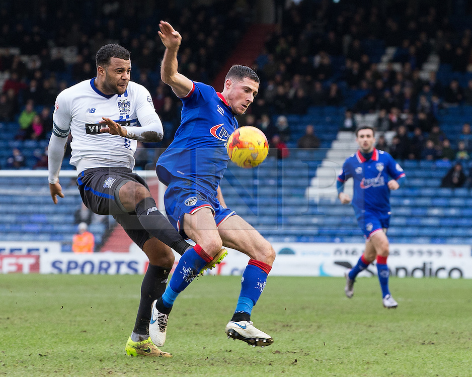 © Licensed to London News Pictures . 23/01/2016 . Oldham , UK . Bury Captain TOM SOARES challenges Oldham's MIKE JONES (r) for the ball . Oldham Athletic vs Bury at Boundary Park . Photo credit : Joel Goodman/LNP