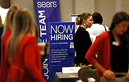 Recruiters and job seekers are seen at a job fair in Golden, Colorado June 7, 2016. REUTERS/Rick Wilking