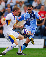 Photo: Leigh Quinnell.<br /> Wycombe Wanderers v Shrewsbury. Coca Cola League 2. 22/09/2007. Wycombes Scott McGleish gets a shot past Shrewsburys Kelvin Langmead.