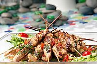 Plate full ok kabobs of chicken teriyaki presented for catering.
