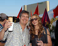 "ATLANTIC CITY, NJ - JUNE 26: Actress Drea De Matteo (R) and Maxim Magazine Editor in Chief Keith Blanchard share a laugh at the Maxim Magazine Presents ""Fantasy Island"" at the Borgata Hotel Casino and Spa June 26, 2004 in Atlantic City, New Jersey. The event consisted of two music stages and four unique themed areas, providing a wide array of entertainment for guests; South Beach Venice Beach, Stuffland, and The Oasis. (Photo by William Thomas Cain/Getty Images)"