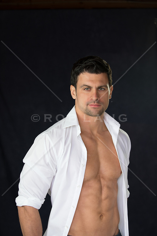 hot guy with green eyes and dark hair with an open white shirt