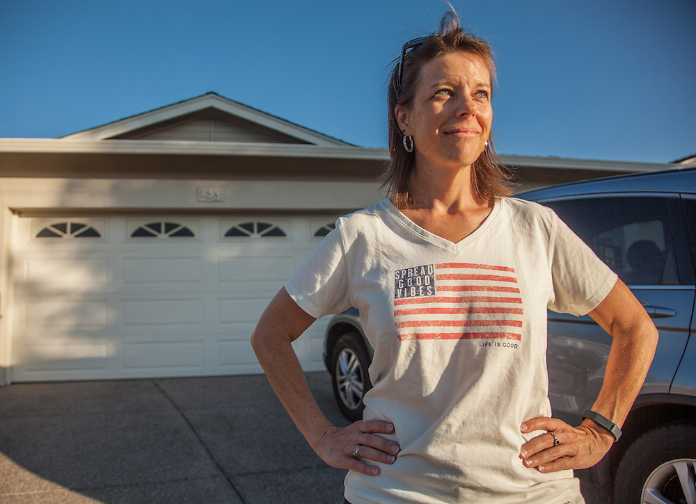 """Education specialist Stacy Freeman in front of her home in Martinez, CA.  """"I am sure my wearing this shirt will make a difference for the American athelets in Rio!"""""""