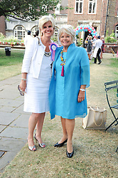 Left to right, LYNN NARRAWAY and JUDITH CHALMERS at the Lord's Taverners Diamond Jubilee Garden Party held in College Gardens, Westminster Abbey, London on 8th July 2010.