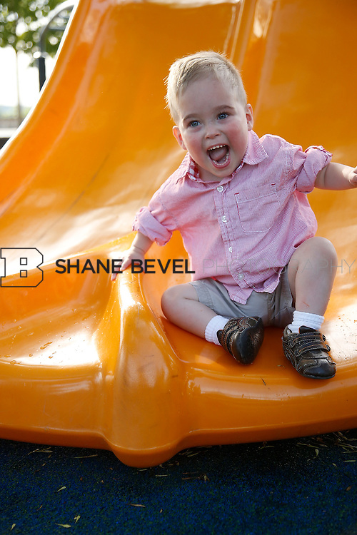 5/28/15 6:06:28 PM -- Miracle Miles and his family pose for portraits and play at the QuikTrip park for the 2015 Saint Francis Health System advertising campaign. <br /> <br /> Photo by Shane Bevel